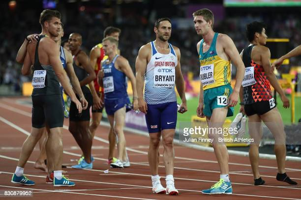 Ashley Bryant of Great Britain and Cedric Dubler of Australia compete in the Men's Decathlon 1500 metres and winning gold during day nine of the 16th...