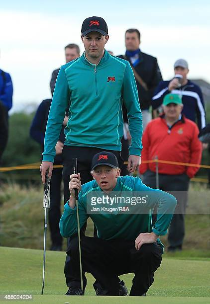 Ashley Chesters and Jimmy Mullen of Great Britain Ireland line up a putt during the Sunday Foursomes on Day Two of the 2015 Walker Cup at Royal...