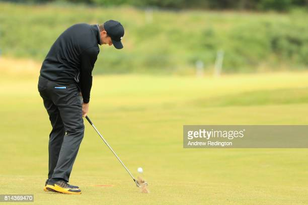Ashley Chesters of England hits his second shot on the 14th hole during day two of the AAM Scottish Open at Dundonald Links Golf Course on July 14...