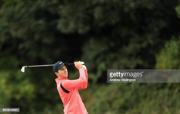 Ashley Chesters of England plays his second shot on the third hole during the third round of the British Masters at Close House Golf Club on...
