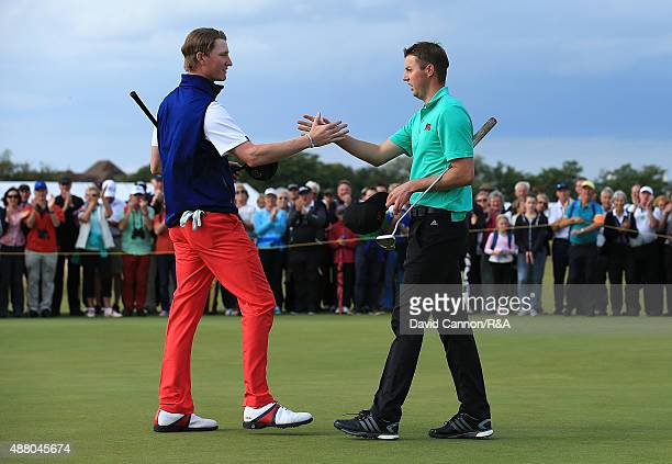 Ashley Chesters of Great Britain Ireland shakes hands with Jordan Niebrugge of the United States at the end of their match during the Sunday Singles...