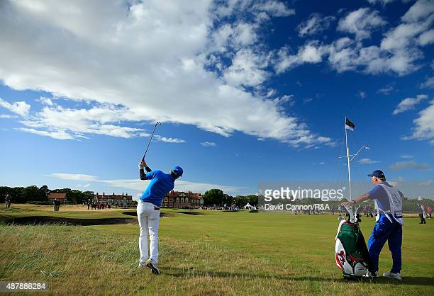 Ashley Chesters of the Great Britain and Ireland Team plays his second shot on the 18th hole in his match against Bryson DeChambeau of the United...