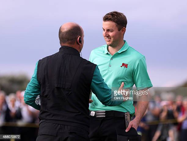 Ashley Chesters of the Great Britain and Ireland Walker Cup Team is congratulated by team captain Nigel Edwards after he wins his afternoon singles...