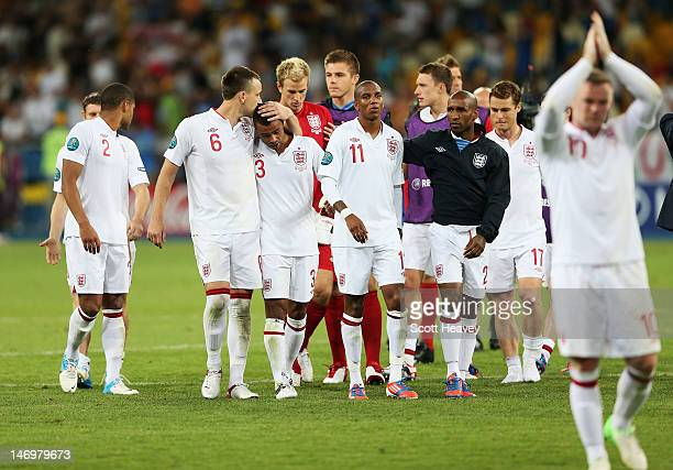 Ashley Cole and Ashley Young of England look dejected after the penalty shoot out during the UEFA EURO 2012 quarter final match between England and...