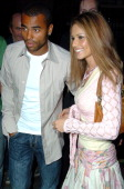 Ashley Cole and Cheryl Tweedy during Ashley Cole Cheryl Tweedy and Louis Walsh Arrive at The Ivy in London August 18 2005 at The Ivy Restaurant in...