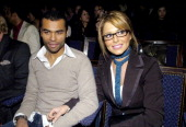 Ashley Cole and Cheryl Tweedy during London Fashion Week Autumn/Winter 2006 Julien MacDonald Front Row at Freemasons Hall in London Great Britain