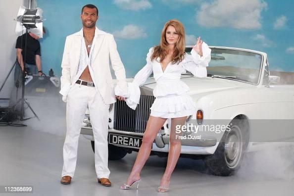 Ashley Cole and Cheryl Tweedy Tweedy is wearing a dress by Robert Cavalli