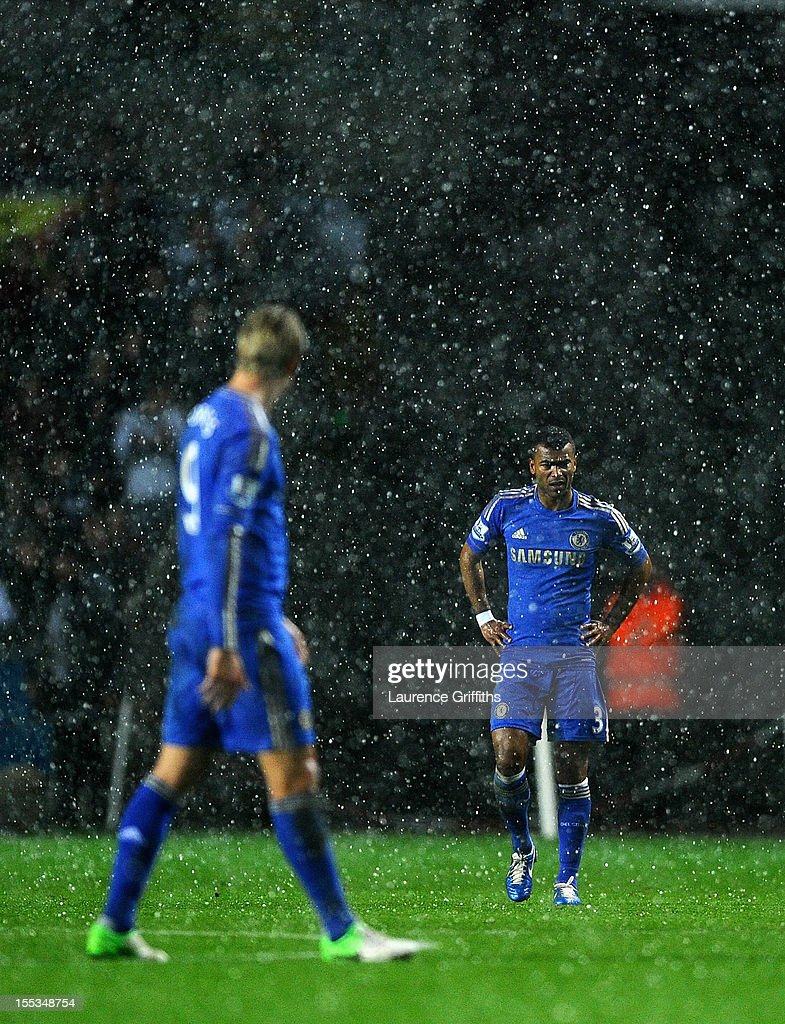 Ashley Cole and Fernando Torres of Chelsea look on in a hail storm during the Barclays Premier League match between Swansea City and Chelsea at Liberty Stadium on November 3, 2012 in Swansea, Wales.