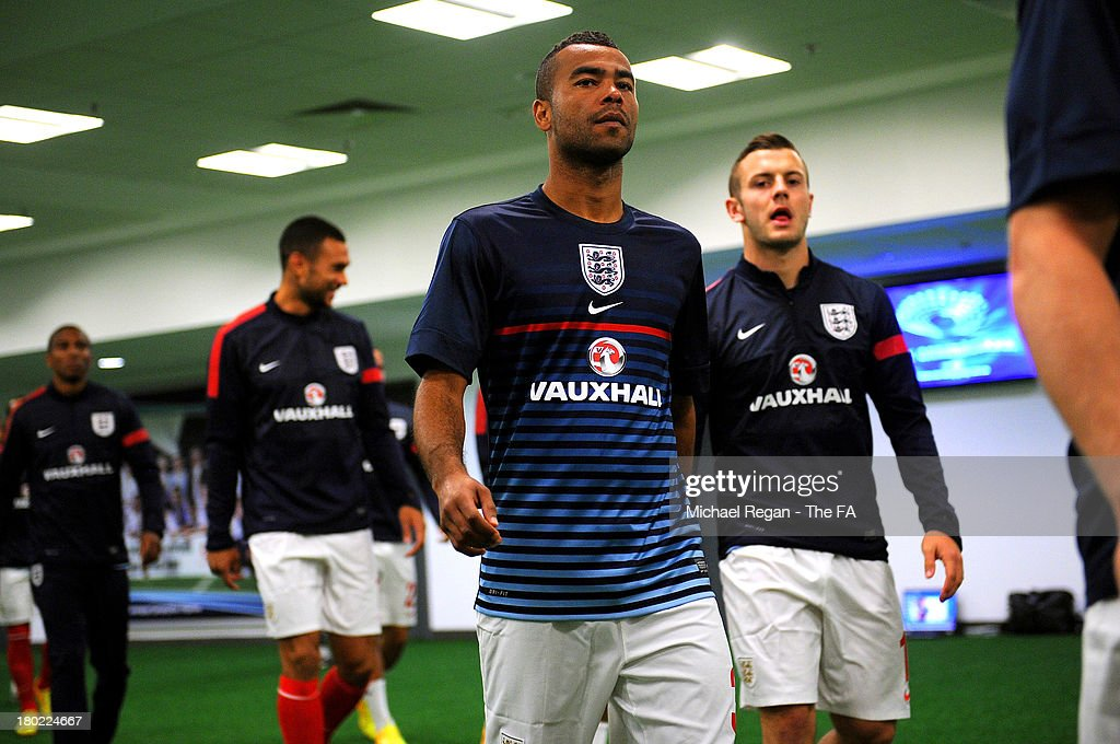 Ashley Cole (L) and Jack Wilshere of England walk out onto the pitch for the warm up prior to during the FIFA 2014 World Cup Qualifying Group H match between Ukraine and England at the Olympic Stadium on September 10, 2013 in Kiev, Ukraine.