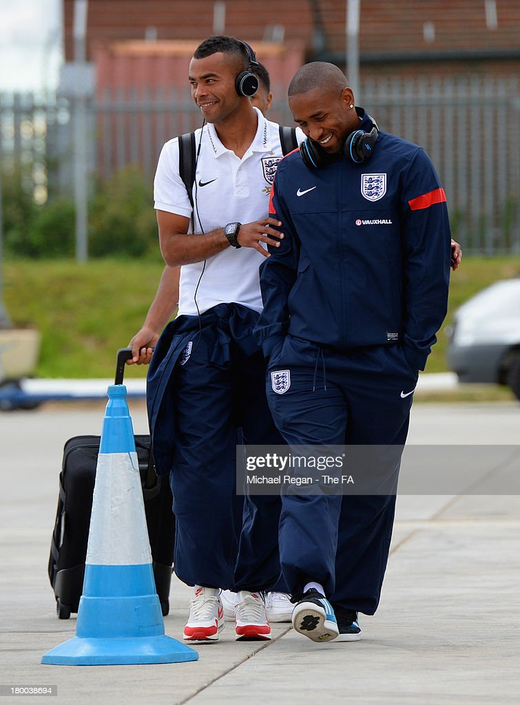 Ashley Cole and Jermain Defoe of England board the plane to Kiev after the England press conference at Luton Airport on September 8, 2013 in Hertford, England.