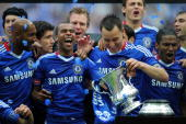 Ashley Cole and John Terry of Chelsea lead the celebrations after winning the FA Cup sponsored by EON Final match between Chelsea and Portsmouth at...