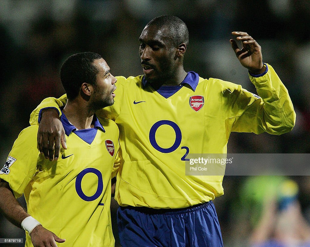 Ashley Cole congratulates Sol Campbell, the goal scorer at the end of the Barclays Premiership match between Portsmouth and Arsenal at Fratton Park on December 19, 2004 in London, England.