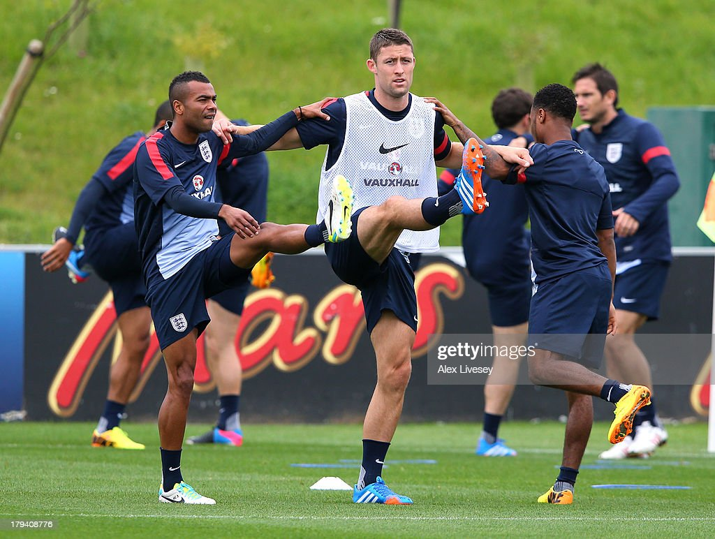 Ashley Cole, Gary Cahill and Raheem Sterling of England warm up during a training session at St Georges Park on September 3, 2013 in Burton-upon-Trent, England.