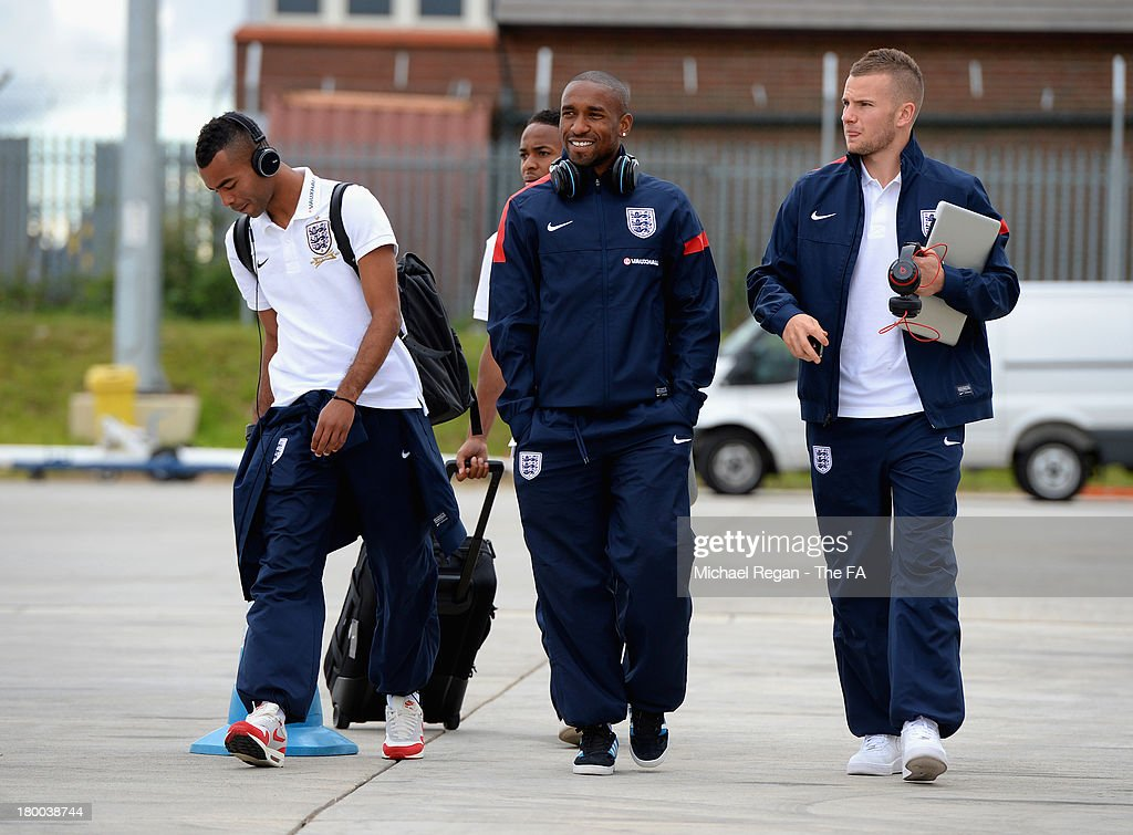 Ashley Cole (L), Jermain Defoe (C) and Tom Cleverley (R) of England board the plane to Kiev after the England press conference at Luton Airport on September 8, 2013 in Hertford, England.