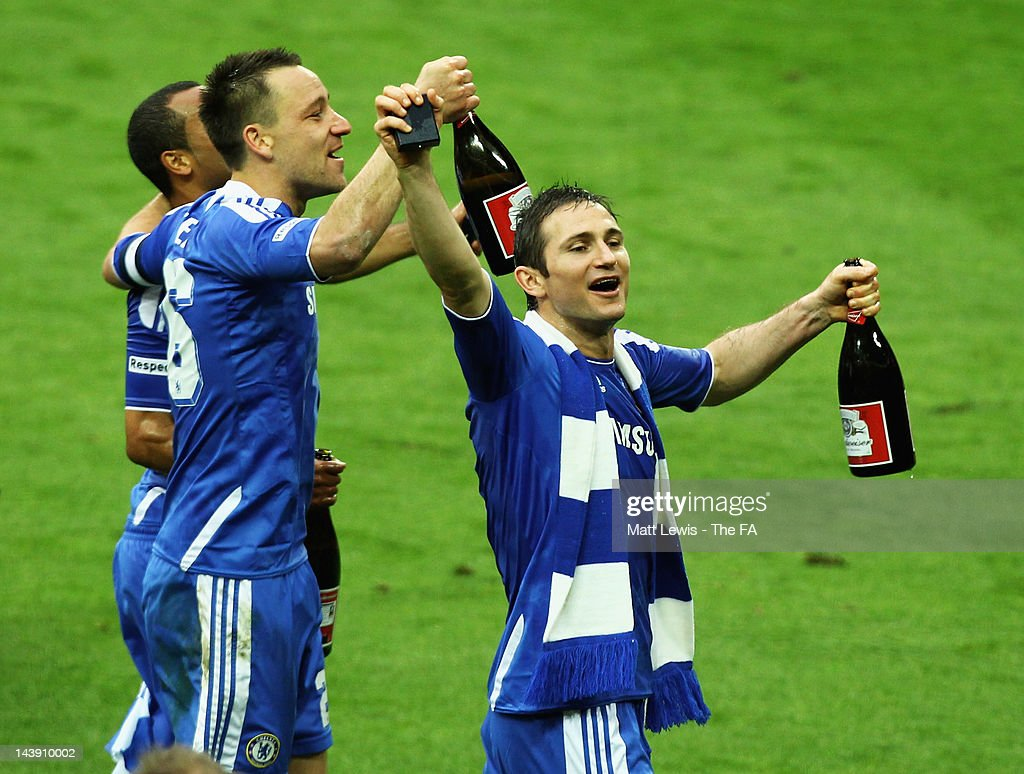 Ashley Cole, John Terry and Frank lampard of Chelsea celebrate their teams win after the FA Cup Final with Budweiser between Liverpool and Chelsea at Wembley Stadium on May 5, 2012 in London, England.