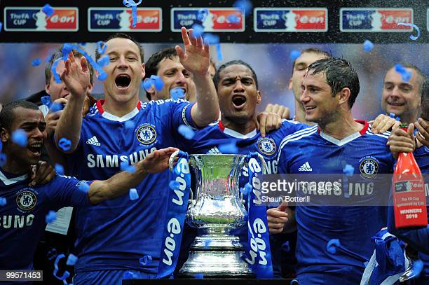 Ashley Cole John Terry Florent Malouda and Frank Lampard of Chelsea lead the celebrations after winning the FA Cup sponsored by EON Final match...