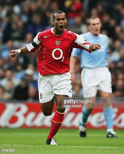 Ashley Cole of Arsenal celebrates after scoring during the Barclays Premiership match between Manchester City and Arsenal at the City of Manchester...