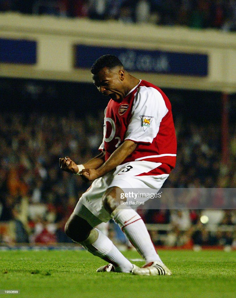 Ashley Cole of Arsenal celebrates during the FA Barclaycard Premiership match between Arsenal and Manchester United held on April 16, 2003 at Highbury in London, England. The match ended in a 2-2 draw.