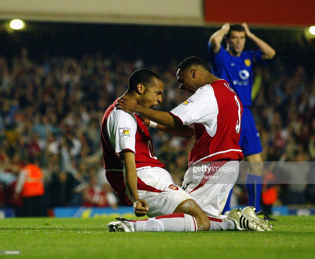 Ashley Cole of Arsenal celebrates with team mate Thierry Henry of Arsenal during the FA Barclaycard Premiership match between Arsenal and Manchester United held on April 16, 2003 at Highbury in London, England. The match ended in a 2-2 draw.