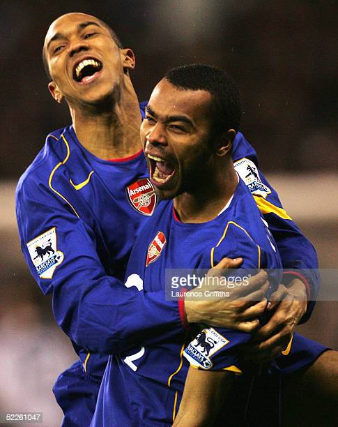 Ashley Cole of Arsenal is congratulated by Gael Clichy after scoring the winning penalty during the FA Cup Fifth Round Replay match between Sheffield...