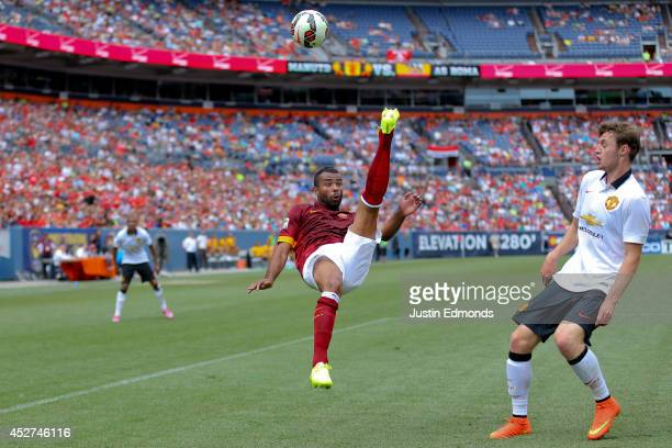 Ashley Cole of AS Roma kicks the ball over his head near William Keane of Manchester United during the second half of an International Champions Cup...