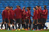 Ashley Cole of AS Roma shares a joke with Maicon during a training session at Etihad Stadium on September 29 2014 in Manchester England