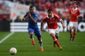 Ashley Cole of Chelsea and Eduardo Salvio of Benfica compete for the ball during the UEFA Europa League Final between SL Benfica and Chelsea FC at...