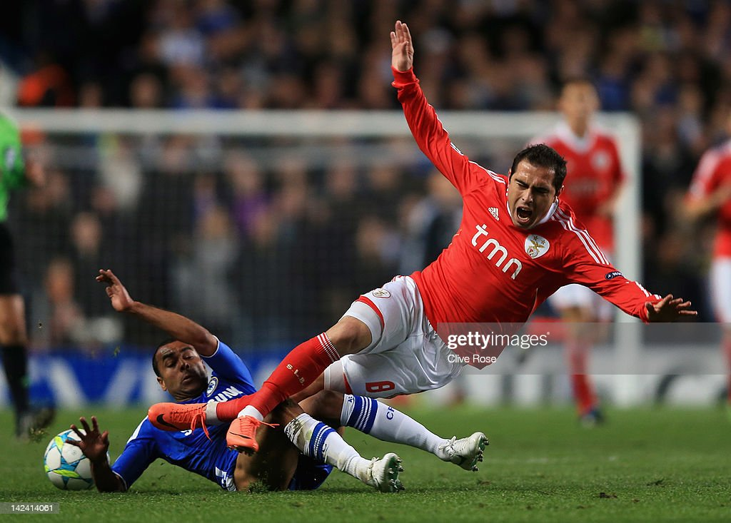 <a gi-track='captionPersonalityLinkClicked' href=/galleries/search?phrase=Ashley+Cole&family=editorial&specificpeople=201831 ng-click='$event.stopPropagation()'>Ashley Cole</a> of Chelsea challenges Bruno Cesar of Benfica during the UEFA Champions League Quarter Final second leg match between Chelsea and Benfica at Stamford Bridge on April 4, 2012 in London, England.