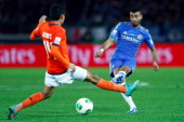 Ashley Cole of Chelsea challenges Jesus Corona of CF Monterrey during the FIFA Club World Cup Semi Final match between CF Monterrey and Chelsea at...