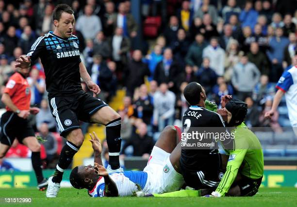 Ashley Cole of Chelsea collides with and subsequently injures team mate Petr Cech during the Barclays Premier League match between Blackburn Rovers...