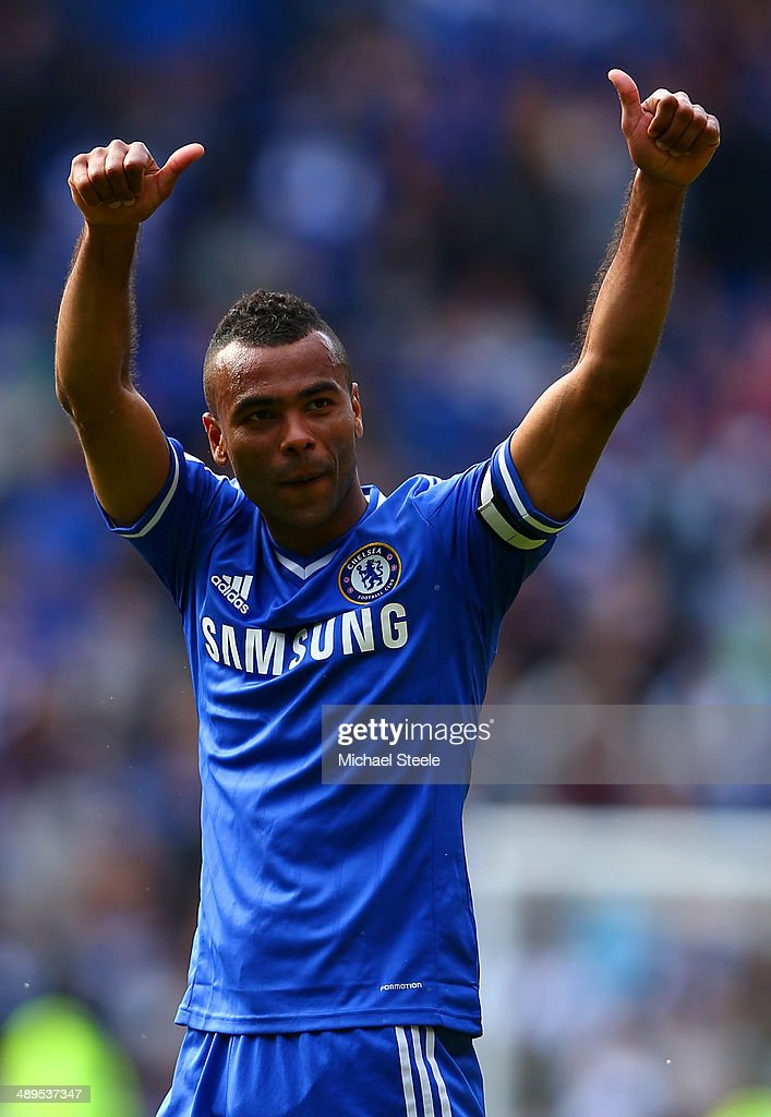 <a gi-track='captionPersonalityLinkClicked' href=/galleries/search?phrase=Ashley+Cole&family=editorial&specificpeople=201831 ng-click='$event.stopPropagation()'>Ashley Cole</a> of Chelsea gives a thumbs up to the fans at the end of the match during the Barclays Premier League match between Cardiff City and Chelsea at Cardiff City Stadium on May 11, 2014 in Cardiff, Wales.