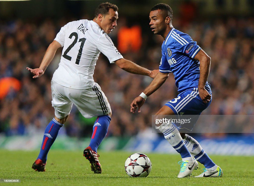 Ashley Cole of Chelsea goes past Marcelo Diaz of FC Basel during the UEFA Champions League Group E Match between Chelsea and FC Basel at Stamford Bridge on September 18, 2013 in London, England.