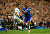 Ashley Cole of Chelsea goes past Nicolae Stanciu of Steaua during the UEFA Champions League Group E match between Chelsea and FC Steaua Bucuresti at...
