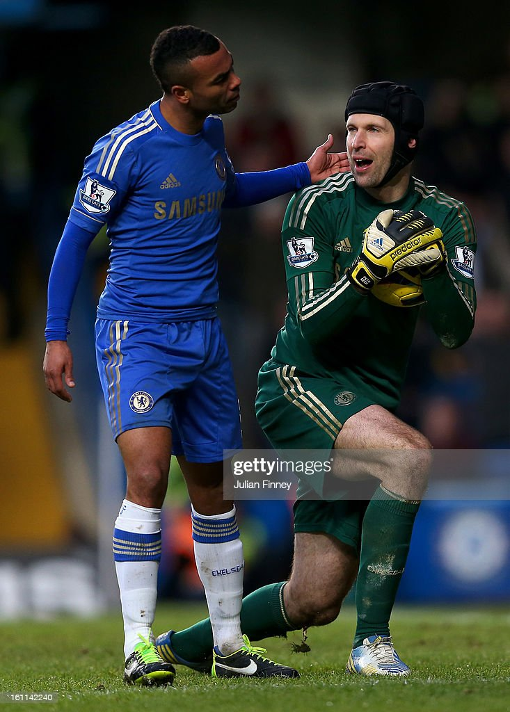 Ashley Cole of Chelsea has a misunderstanding with Petr Cech of Chelsea during the Barclays Premier League match between Chelsea and Wigan Athletic at Stamford Bridge on February 9, 2013 in London, England.