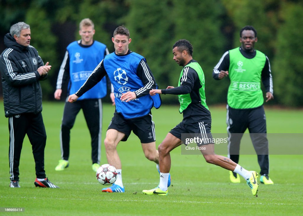Ashley Cole of Chelsea is challenged by Gary Cahill during a Chelsea training session on November 5 2013 in Cobham England