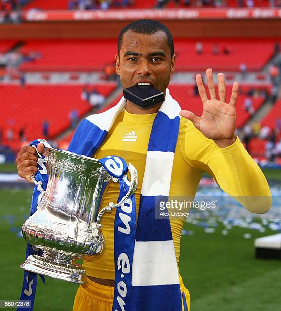 Ashley Cole of Chelsea lifts the trophy after winning his fifth medal during the FA Cup sponsored by EON Final match between Chelsea and Everton at...