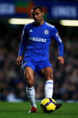 Ashley Cole of Chelsea passes the ball during the Barclays Premier League match between Chelsea and Everton at Stamford Bridge on December 12 2009 in...