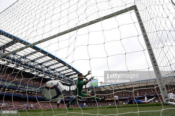 Ashley Cole of Chelsea scores past Tottenham Hotspur goalkeeper Carlo Cudicini during the Barclays Premier League match between Chelsea and Tottenham...