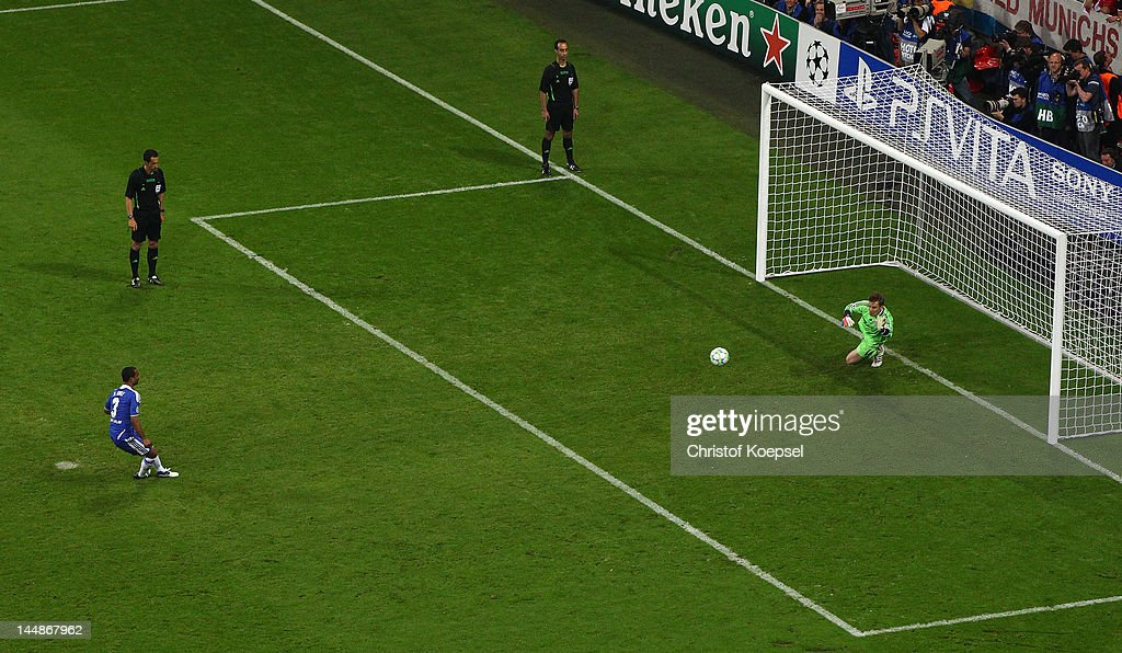 Ashley Cole of Chelsea shoots past Manuel Neuer of FC Bayern Muenchen to score a penalty in the shoot out during UEFA Champions League Final between FC Bayern Muenchen and Chelsea at the Fussball Arena München on May 19, 2012 in Munich, Germany.