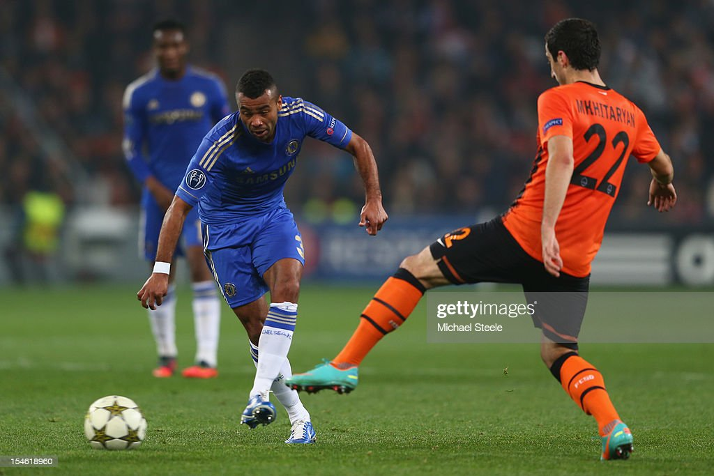 Ashley Cole (L) of Chelsea threads a pass past Henrik Mkhitaryan (R) of Shakhtar Donetsk during the UEFA Champions League Group E match between Shakhtar Donetsk and Chelsea at the Donbass Arena on October 23, 2012 in Donetsk, Ukraine.