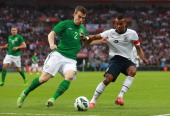 Ashley Cole of England battles with Seamus Coleman of the Republic of Ireland during the International Friendly match between England and the...