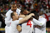 Ashley Cole of England celebrates with teammates after Steven Gerrard scores the opening goal during the 2010 FIFA World Cup South Africa Group C...