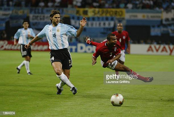 Ashley Cole of England is brought down by Mauricio Pochettino of Argentina during the England v Argentina Group F World Cup Group Stage match played...