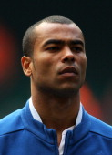 Ashley Cole of England looks on during the UEFA EURO 2012 Group G qualifying match between Wales and England at the Millennium Stadium on March 26...