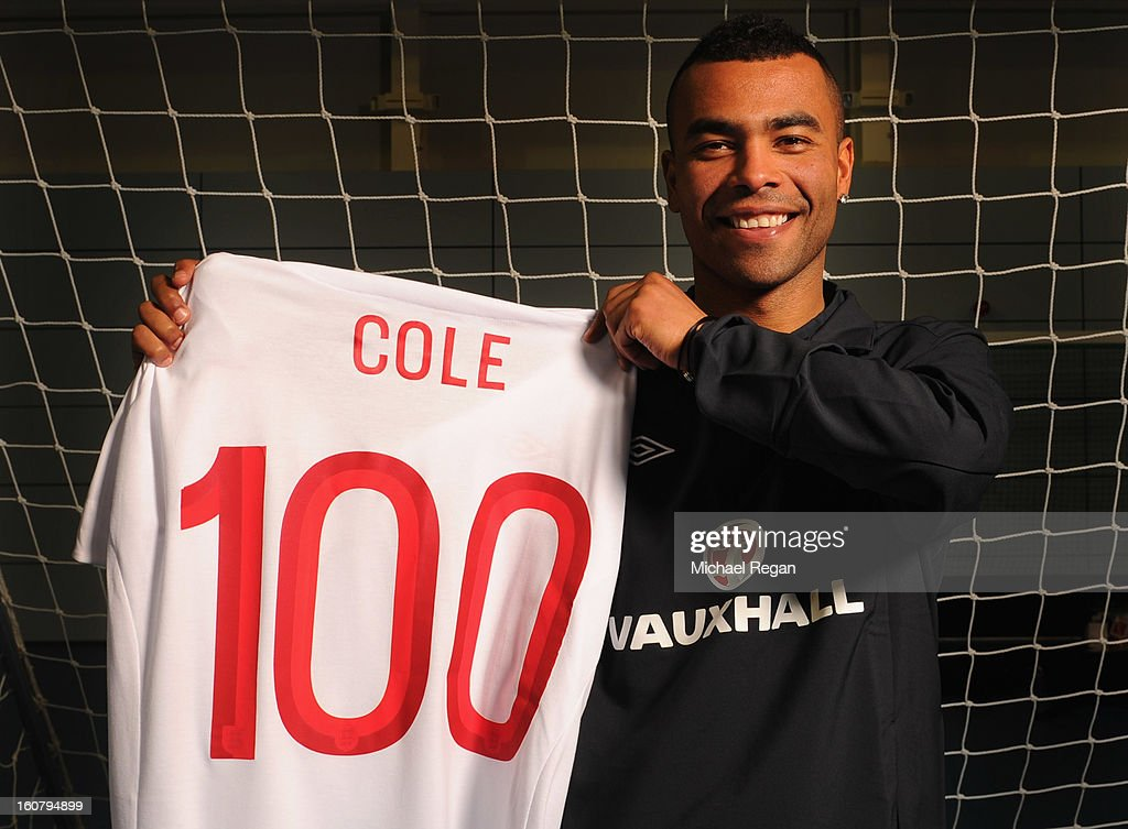 Ashley Cole of England poses with a shirt to celebrate reaching 100 caps in Wednesday's friendly international against Brazil at Wembley, following an Engand training session at St Georges Park on February 4, 2013 in Burton-upon-Trent, England.