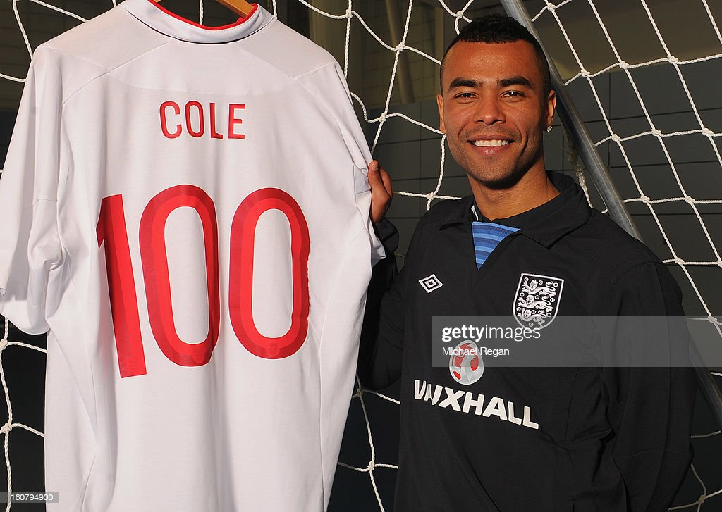<a gi-track='captionPersonalityLinkClicked' href=/galleries/search?phrase=Ashley+Cole&family=editorial&specificpeople=201831 ng-click='$event.stopPropagation()'>Ashley Cole</a> of England poses with a shirt to celebrate reaching 100 caps in Wednesday's friendly international against Brazil at Wembley, following an Engand training session at St Georges Park on February 4, 2013 in Burton-upon-Trent, England.