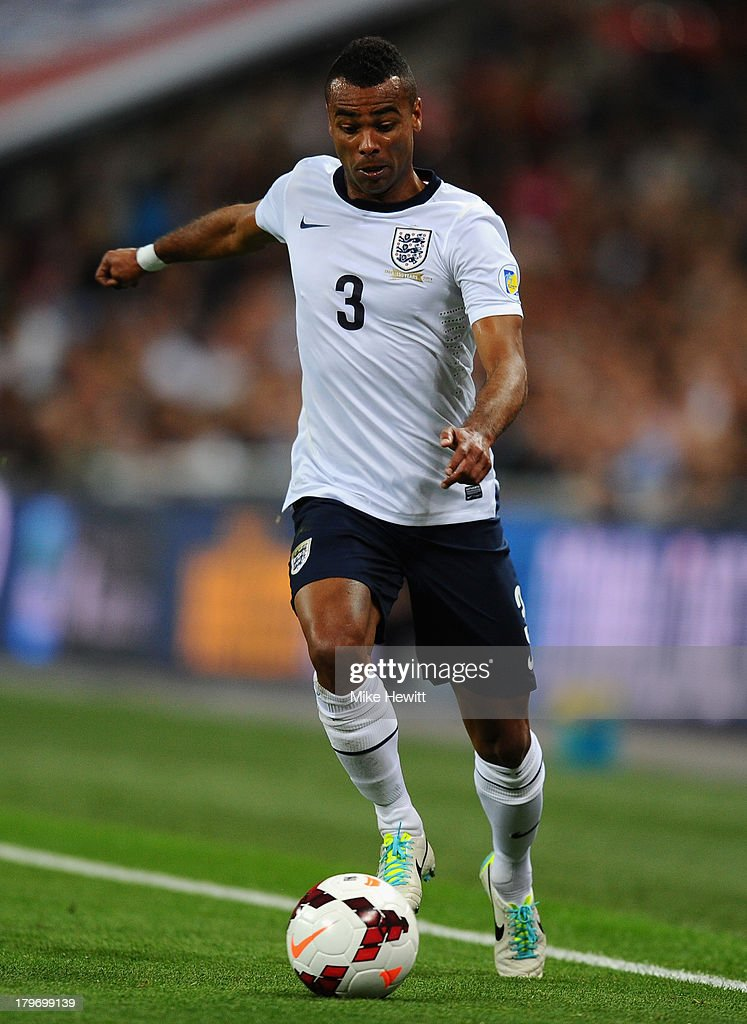Ashley Cole of England runs with the ball during the FIFA 2014 World Cup Qualifying Group H match between England and Moldova at Wembley Stadium on September 6, 2013 in London, England.