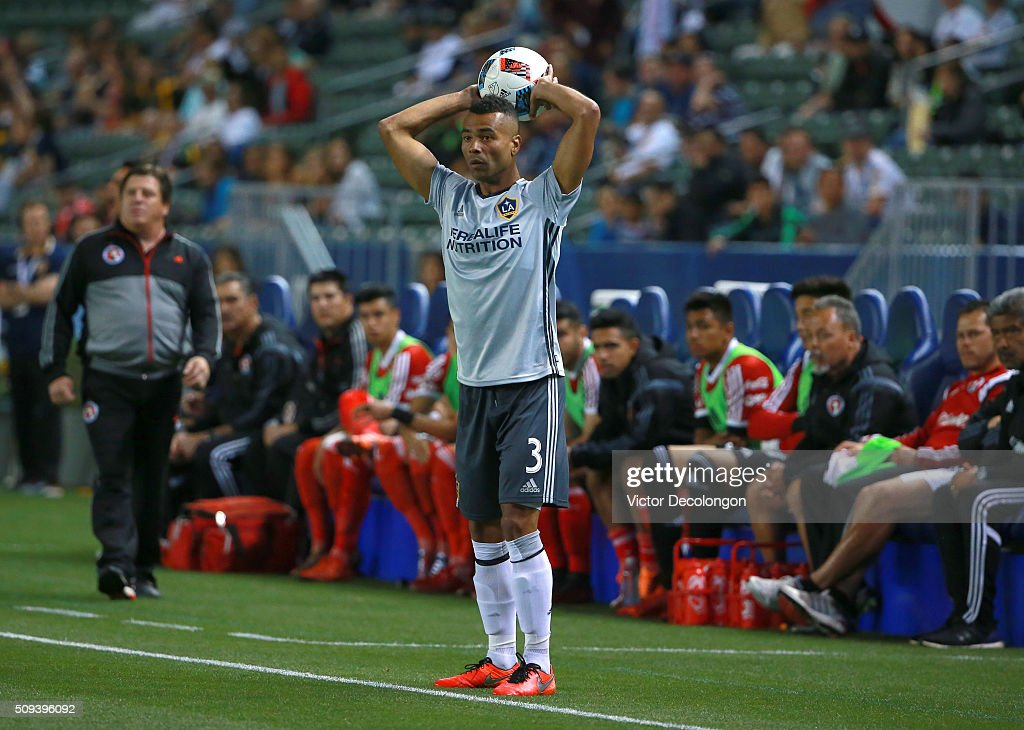 <a gi-track='captionPersonalityLinkClicked' href=/galleries/search?phrase=Ashley+Cole&family=editorial&specificpeople=201831 ng-click='$event.stopPropagation()'>Ashley Cole</a> #3 of Los Angeles Galaxy throws in the ball as head coach <a gi-track='captionPersonalityLinkClicked' href=/galleries/search?phrase=Miguel+Herrera+-+Soccer+Coach&family=editorial&specificpeople=12319687 ng-click='$event.stopPropagation()'>Miguel Herrera</a> of Club Tijuana looks on during first half of their club friendly match at StubHub Center on February 9, 2016 in Carson, California. Club Tijuana and the Los Angeles Galaxy played to a 0-0 draw.