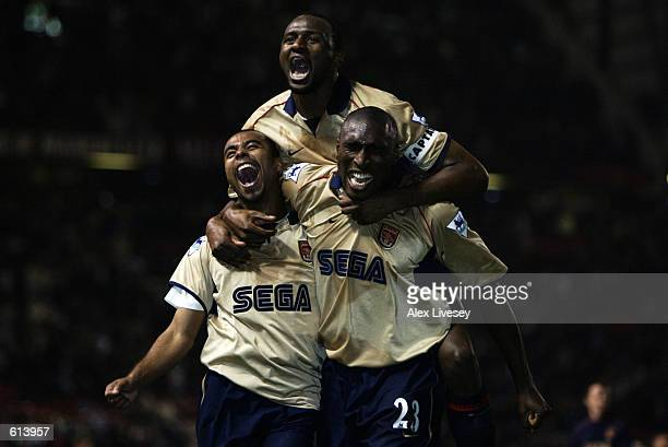 Ashley Cole Patrick Vieira and Sol Campbell of Arsenal celebrate during the FA Barclaycard Premiership match between Manchester United and Arsenal...