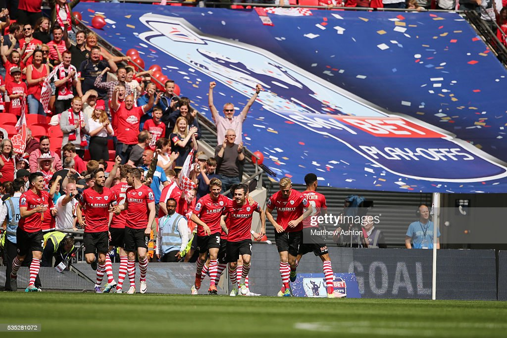 Ashley Fletcher of Barnsley celebrates after scoring a goal to make it 1-0 during the Sky Bet League One Play Off Final between Barnsley and Millwall at Wembley Stadium on May 29, 2016 in London, England.